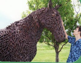 Horse statue made of chain, Gabe petting